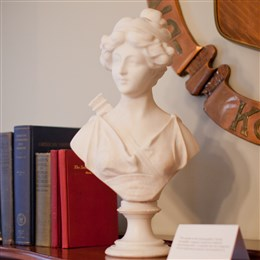The bust of Psyche in the Women of Achievement/Small Conference Room was donated in 1993 by Martha Wilson MacDonald, Pittsburgh - Omicron, 1988 Woman of Year, whose display hangs on the wall overlooking Psyche. The bust was a wedding gift from Martha's sister in 1912 and was made in Italy in 1900. The myths of the Greek goddess Psyche exemplify a woman's search for authentic personal growth, a reminder that the integration of our experiences matures and transforms us.